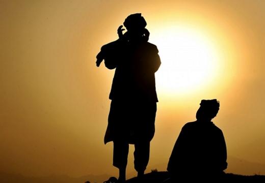 мусульмане на фоне солнца