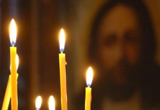 свечи перед иконой